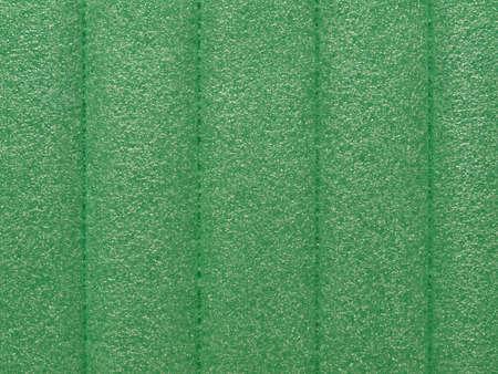 propylene: Green soft polypropylene pillow useful as a background Stock Photo