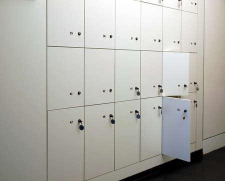 locker room: Lockers cabinets in a locker room at school or museum or station