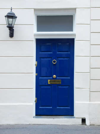 Brightly coloured traditional English house door in London photo