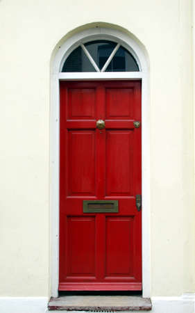 english house: Brightly coloured traditional English house door in London