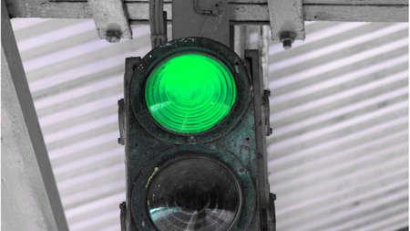 authorisation: Green light on a traffic light or semaphore