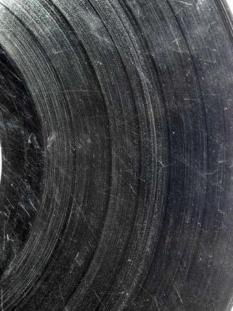 Badly damaged scratched vinyl record vintage analog music recording medium Stock Photo - 7128814