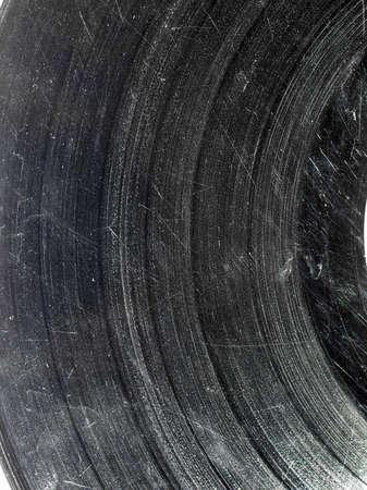 Badly damaged scratched vinyl record vintage analog music recording medium Stock Photo - 7128815