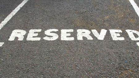 reserved sign: A road sign for a reserved parking area