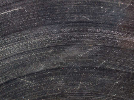 Badly damaged scratched vinyl record vintage analog music recording medium photo