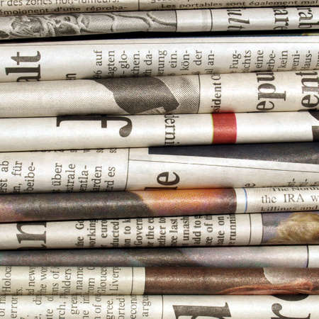 pile of newspapers: Detail of a pile of international newspapers Stock Photo
