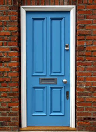 Brightly coloured traditional English house door in London