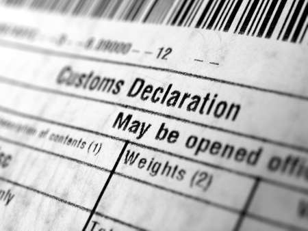 Customs declaration on a foreign packet parcel 版權商用圖片