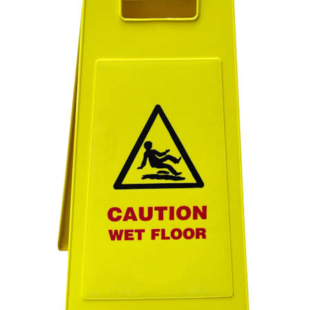 Caution wet floor and slippery surface sign - isolated over white background photo