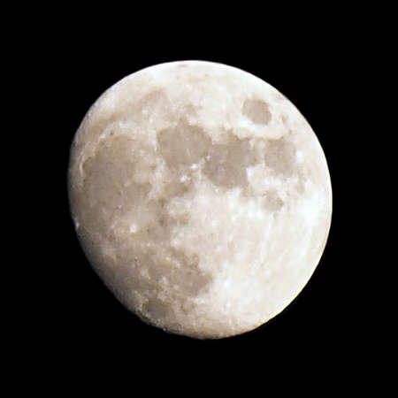 Full moon over a dark black sky