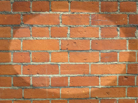 Red brick wall useful as a background photo