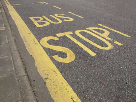 Sign of a bus stop in a road or street photo