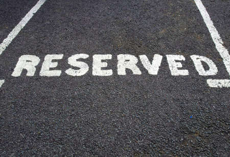 reserved: A road sign for a reserved parking area