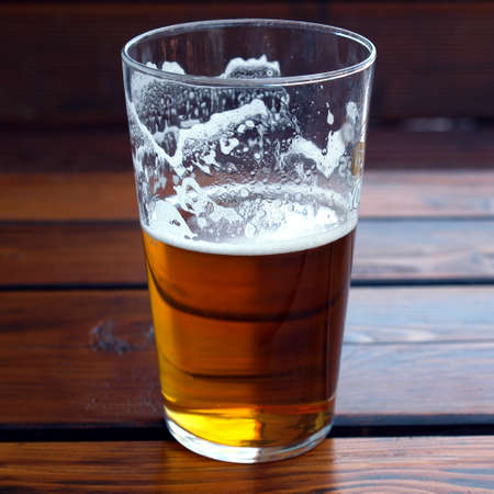 beer pint: Large glass pint of beer alcoholic drink Stock Photo