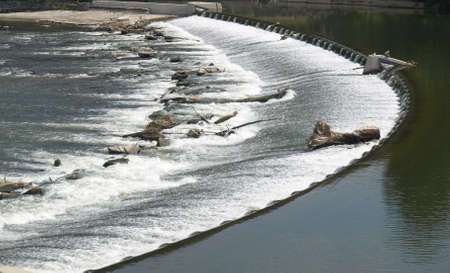 retaining: A dam for blocking or retaining a stream of water