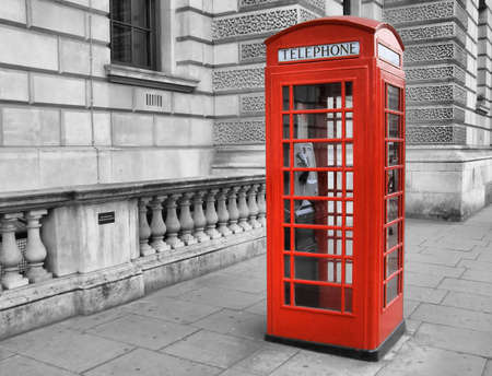 Traditional red telephone box in London, UK - high dynamic range HDR photo