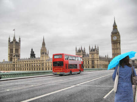 to chime: Rainy day at the Houses of Parliament with red bus and blue girl, London, UK Stock Photo