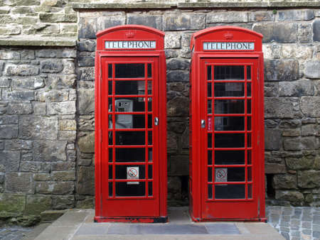 Traditional red telephone box in London, UK 스톡 콘텐츠