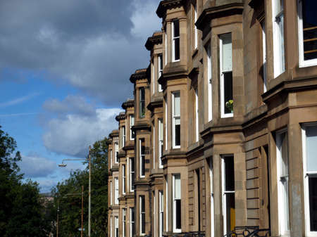 row house: A row of terraced houses in Glasgow West End, Scotland Stock Photo