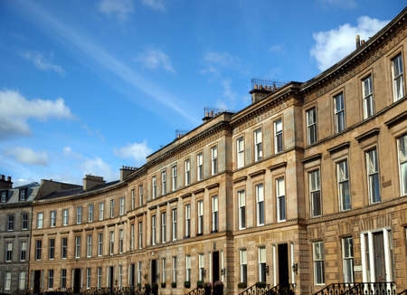 row of houses: A row of terraced houses in Glasgow West End, Scotland Stock Photo