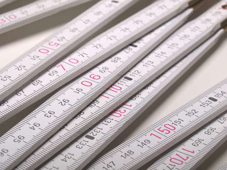 wooden metre: Wooden carpenter ruler for measurements in building site Stock Photo