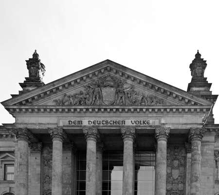 Reichstag (The German Parliament) in Berlin, Germany - rectilinear frontal view photo