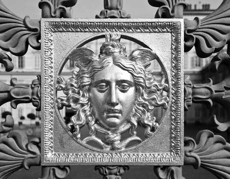 reale: Ancient baroque golden mask on a fence, Palazzo Reale, Turin, Italy Stock Photo