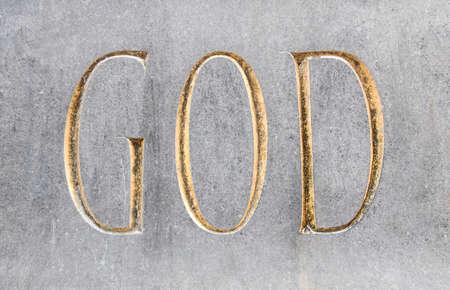 God written in golden font in stone