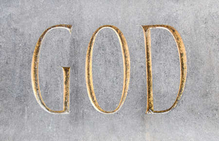 God written in golden font in stone