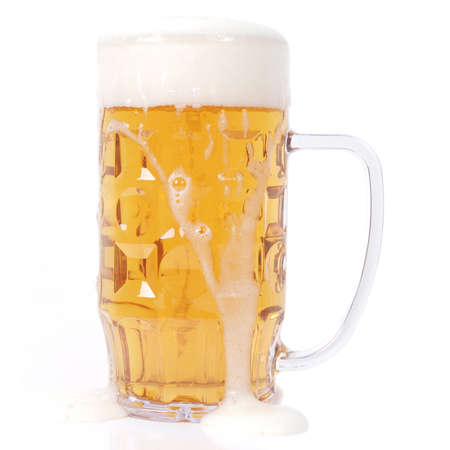 Large German bierkrug beer mug tankard glass of Lager - isolated over white background photo