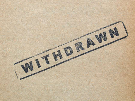 withdrawn: Withdrawn stamp on a book page