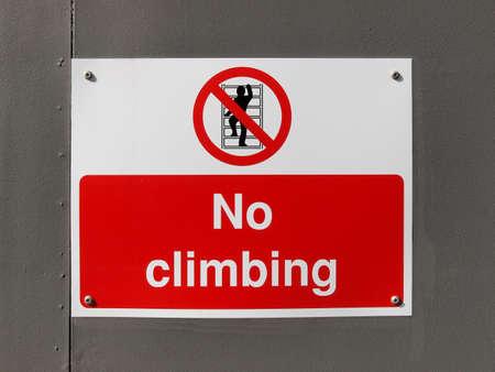 A no climbing warning sign of danger