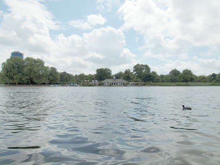 Serpentine lake river in Hyde Park Kensington Gardens London UK photo