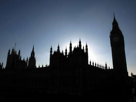 Goth night view silhouette with moon light of the Houses of Parliament Westminster Palace London photo
