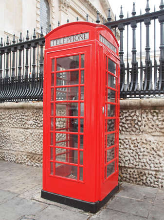 Traditional red telephone box in London UK photo