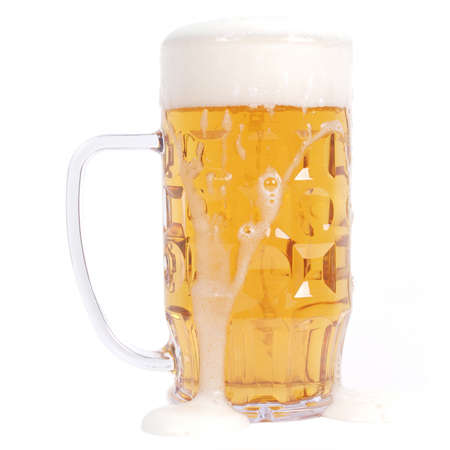 Large German bierkrug beer mug glass of Lager - isolated over white background Фото со стока