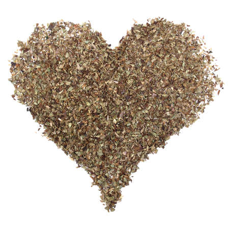 wild marjoram: Wild marjoram origanum spice used in mediterranean area - heart shaped figure meaning love over white background