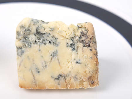 Blue Stilton cheese, traditional fine British food from the English Midlands - in a dish photo