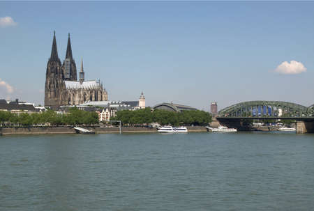 Koeln (Germany) panorama including the gothic cathedral and steel bridge over river Rhine Stock Photo - 14089514