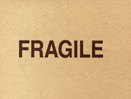 Fragile written on a corrugated cardboard packet photo