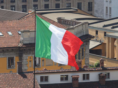 reale: Italian flag of Italy on the roof of Palazzo Reale (Royal Palace) in Milan Stock Photo