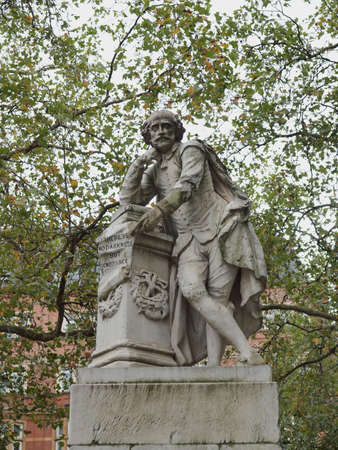 Statue of William Shakespeare (year 1874) in Leicester square London UK photo
