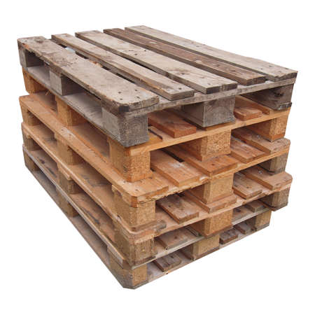 on the skids: Pile of wooden pallets or skids - isolated over white background