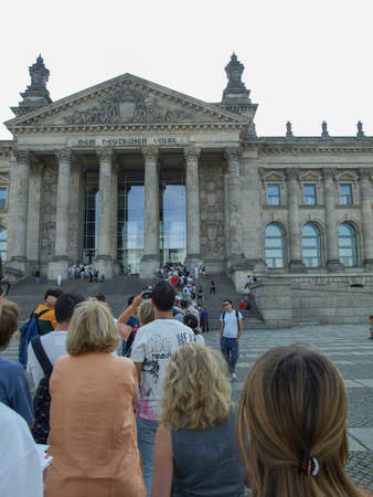 queueing: BERLIN, GERMANY - AUGUST 7: People queueing to visit the Reichstag (The German Parliament) in Berlin Germany on August 7, 2009 in Berlin, Germany