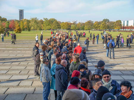 queueing: BERLIN, GERMANY - OCTOBER 23: People queueing to visit the Reichstag (The German Parliament) in Berlin Germany on October 23, 2010 in Berlin, Germany