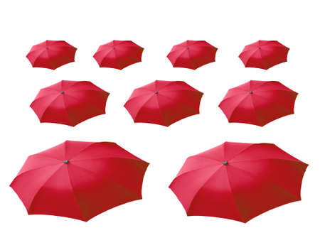 surrealist: Surrealist perspective of many red umbrellas over white Stock Photo