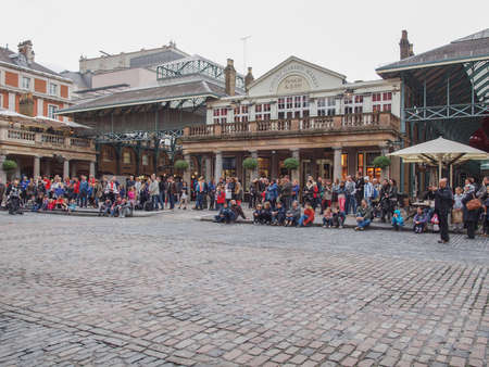 covent: LONDON, ENGLAND, UK - OCTOBER 23: Tourists visiting the world famous Covent Garden on October 23, 2013 in London, England, UK Editorial