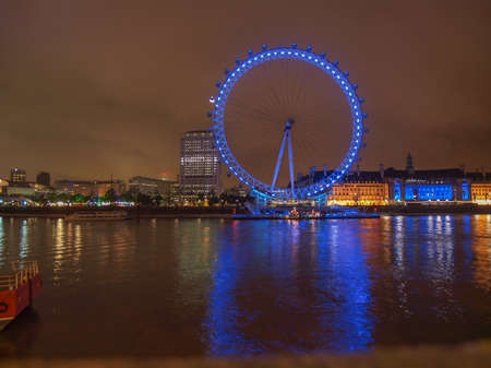 aeronautical: LONDON, ENGLAND, UK - JUNE 18, 2011: Night view of the London Eye ferris wheel on the South Bank of River Thames aka Millennium Wheel built in 1999 using advanced aeronautical engineering know how by British Airways
