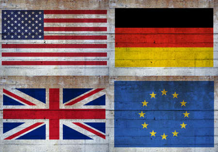 Flags of the United States, UK, Europe and Germany over a grunge concrete wall background photo
