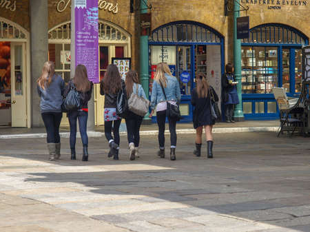 occupied: Girls visiting the shopping centre in newly redeveloped Docklands area once occupied by docks